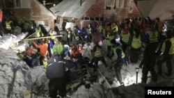 Search crew work in an area hit by an avalanche in Longyearbyen, the main settlement of the remote Arctic archipelago of Svalbard, Norway, Dec. 19, 2015.