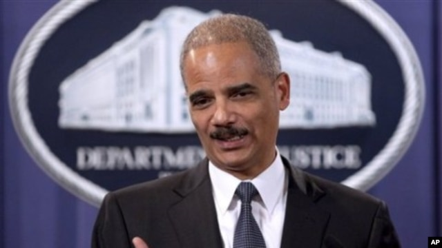 Attorney General Eric Holder takes part in a news conference at the Justice Department in Washington, 06 Dec 2010