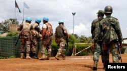 FILE - U.N. peacekeepers and members of the Congolese army in Mavivi, near Beni, North Kivu province, Oct. 22, 2014. Thirty North Korean military instructors may have violated U.N. sanctions by providing pistols to Congolese army and police officers, the United Nations said in a new report.