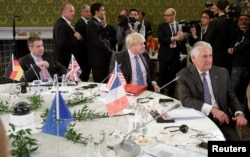 German Foreign Minister Sigmar Gabriel (L), Britain's Foreign Secretary Boris Johnson (C), and U.S. Secretary of State Rex Tillerson attend roundtable talks during a G-7 for foreign ministers in Lucca, Italy, April 11, 2017.
