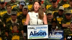 FILE - Kentucky Democratic Senatorial candidate Alison Lundergan Grimes speaks to a group of supporters, including members of the United Mine Workers Association.