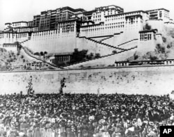 In this March 17, 1959 file photo thousands of Tibetan women silently surround the Potala Palace, the main residence of the Dalai Lama, the Tibetan leader, to protest against Chinese rule.