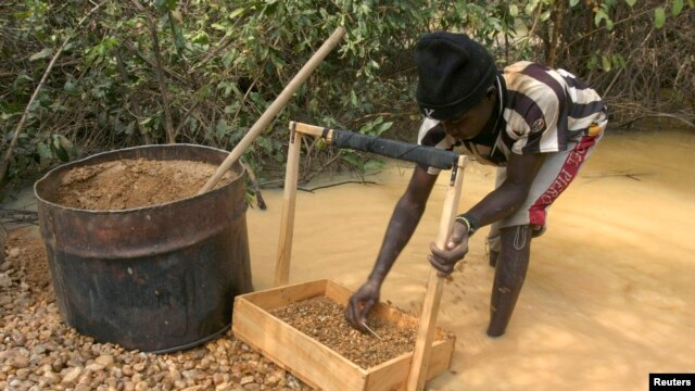Villager searches for diamonds in gravel near mine outside of Sam Ouandja, northeastn Central African Republic, undated file photo.