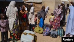 FILE - Families from Gwoza, Borno State, displaced by the violence and unrest caused by the insurgency, are seen at a refugee camp in Mararaba Madagali, Adamawa State, Feb. 18, 2014.