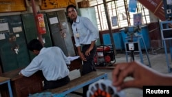 Students work at the electrical department of the Industrial Training Institute in Beed, about 350 km (220 miles) east of Mumbai, June 28, 2012.