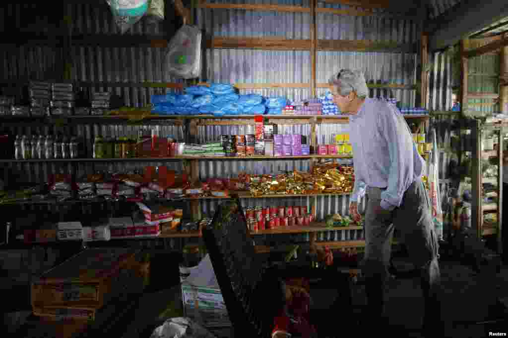 U.S. Secretary of State John Kerry visits a shop along the Mekong River Delta, Vietnam, Dec. 15, 2013.
