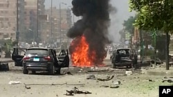 Black smoke billows from a burning car moments after a bomb attack targeted the convoy of Egypt's Interior Minister Mohammed Ibrahim, in Nasr City, Egypt, Sept. 5, 2013 (AP Photo File)