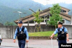 Police officers are seen in front of a facility for the disabled, where at least 19 people were killed by a knife-wielding man in Sagamihara, Kanagawa prefecture, Japan, July 26, 2016.