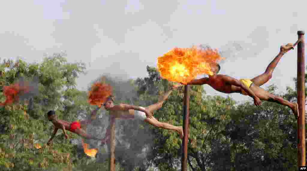 Indian soldiers take part in a demonstration of 'fire breathing' at the start of Operation Hand in Hand - a joint training exercise between Indian and Chinese troops - at Aundh Military Camp in Pune, Nov. 18, 2014.