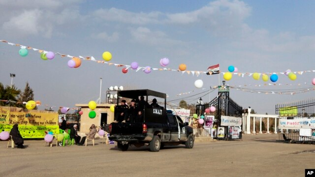 In this file photo taken February 17, 2012, Iraqi security forces are seen entering through the main gate of Camp Ashraf, northeast of Baghdad.