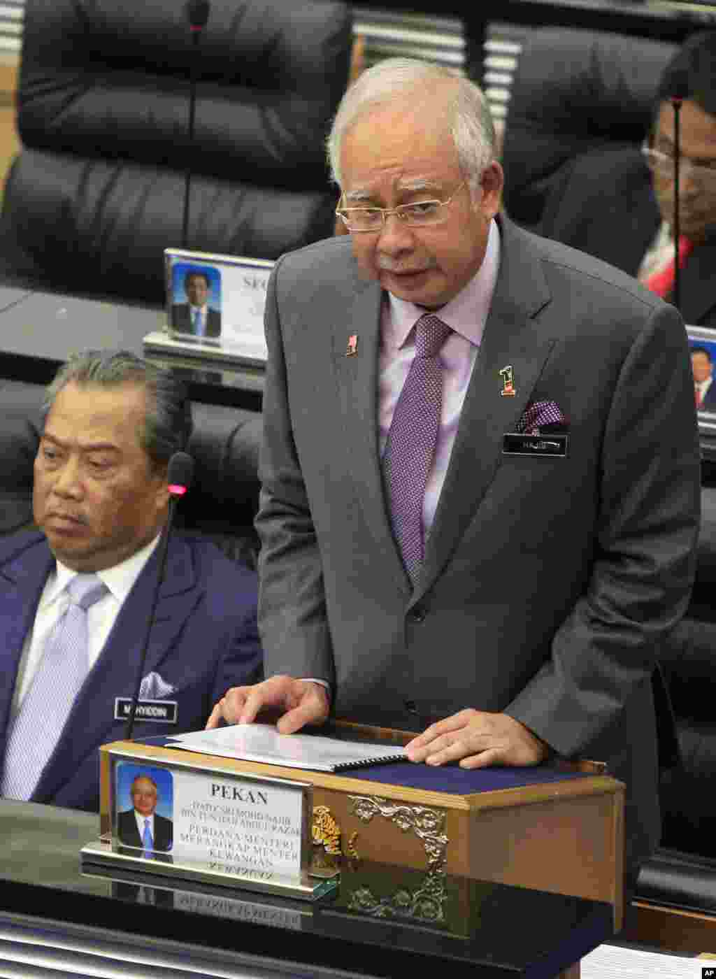 Malaysian Prime Minister Najib Razak tables an emergency motion to condemn the downing of Malaysia Airlines Flight 17 in eastern Ukraine, at Parliament House in Kuala Lumpur, July 23, 2014.