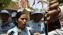 Cambodian protester Tep Vanny, center, talks with journalists after she and a group of others from Beung Kak lake submitted a petition to the National Assembly asking the government to return the title of their land, in Phnom Penh, Cambodia, Wednesday, May 2, 2012. (AP Photo/Heng Sinith)