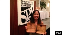 VOA stringer Heidi Chang accepts the SPJ awards