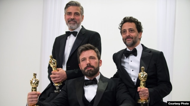 "Producers George Cloney, Ben Affleck, and Grant Heslov pose backstage with their Oscars® for best motion picture of the year for ""Argo"".(Photo: Matt Petit / ©A.M.P.A.S)"