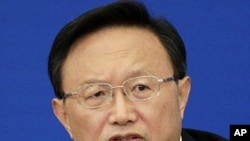 China's Foreign Minister Yang Jiechi answers a reporter's question in Beijing, March 7, 2011