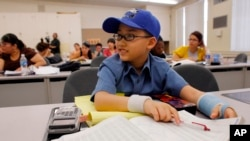Moshe Kai Cavalin, 10, takes statistics college classes at the East Los Angeles College in Los Angeles, California.