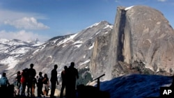 In this 2005 file photo, visitors view Half Dome from Glacier Point at Yosemite National Park, Calif. (AP Photo)