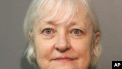 FILE - This January 2018, file photo provided by the Chicago Police Department shows Marilyn Hartman, who added this month to her arrest record for sneaking onto planes after what police say was a ticketless flight from Chicago to London has been ordered released from jail, a judge said Thursday, Jan. 25, 2018.