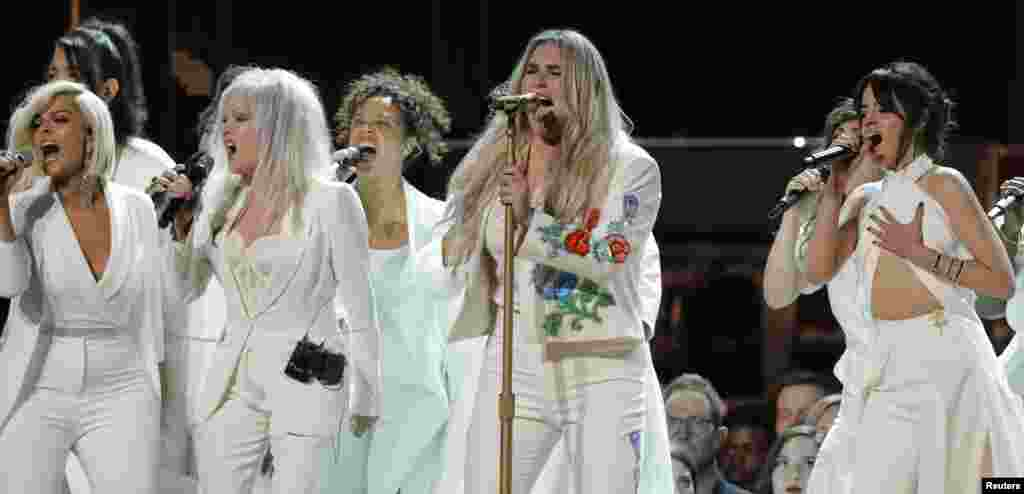 "Kesha (2nd from R) performs ""Praying"" with Bebe Rexha (L), Cyndi Lauper and Camila Cabello (R) during the 60th Annual Grammy Awards show in New York, Jan. 28, 2018."