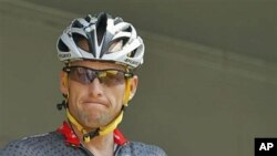 Lance Armstrong grimaces prior to the start of the third stage of the Tour de France cycling race in Wanze, Belgium, July 6, 2010 (file photo)