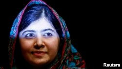 Pakistani schoolgirl Malala Yousafzai, the joint winner of the Nobel Peace Prize, leaves after speaking at Birmingham library in Birmingham, central England, Oct 10, 2014.