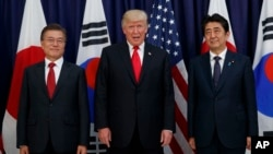 President Donald Trump meets with Japanese Prime Minister Shinzo Abe, right, and South Korean President Moon Jae-in before the Northeast Asia Security dinner at the US Consulate General in Hamburg, Germany, July 6, 2017.