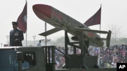 "Pakistan's nuclear-capable air-launched ""Ra'ad"" cruise missile is driven past crowds during the National Day military parade in Islamabad, March 23, 2008"