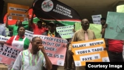 FILE: Teachers protesting against low pay and poor working conditions.