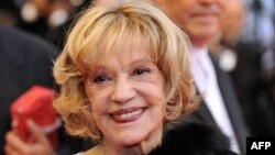FILE - French actress Jeanne Moreau smiles as she arrives to attend the screening of US director Woody Allen's film 'Vicky Cristina Barcelona' at the 61st Cannes International Film Festival,n May 17, 2008, in Cannes, southern France.