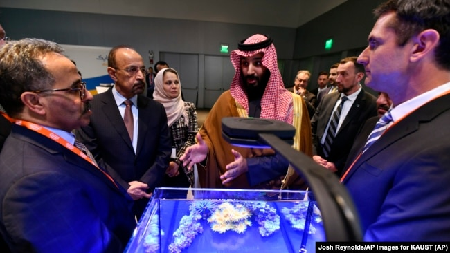 Saudi Crown Prince Mohammed bin Salman view a showing of Saudi Arabian technology, including an exhibit by King Abdullah University of Science and Technology, during a visit to Massachusetts Institute of Technology on Saturday, March 24, 2018.