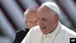 FILE - Pope Francis arrives to hold a Mass in Holguin, Cuba, Sept. 21, 2015.