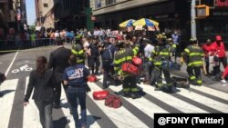 NY Fire Department reports 13 patients are being treated on the scene of the motor vehicle accident in Times Square, May 18, 2017.