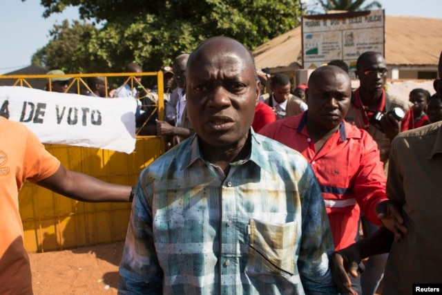 Presidential candidate Jose Mario Vaz leaves a polling station after voting in Bissau, April 13, 2014.