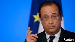 FILE - France's President Francois Hollande, Aug. 27, 2013.