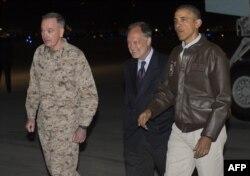 U.S. President Barack Obama greets U.S. Ambassador to Afghanistan James Cunningham (C) and Gen. Joseph Dunfore, Commander of ISAF and U.S. Forces Afghanistan, during a surprise visit to the troops at Bagram Air Field, Kabul, Afghanistan, May 25, 2014.