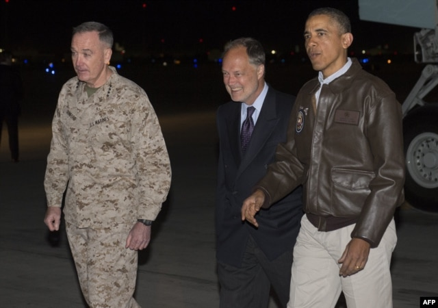 U.S. President Barack Obama greets U.S. Ambassador to Afghanistan James Cunningham (C) and Gen. Joseph Dunfore, Commander of ISAF and U.S. Forces Afghanistan, during a surprise visit to the troops at Bagram Air Field, Kabul, Afghanistan, May 25, 2014.