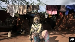 Suban Abdi, who claims one of her sons was recruited into mercenary forces trained by the Kenyan army, sits in a refugee camp, in Dadaab, eastern Kenya. (file photo)