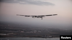 FILE - The Solar Impulse 2 airplane, flown by test pilot Markus Scherdel, flies off the coast of Oahu during a test flight from Kalaealoa Airfield in Kapolei, Hawaii, March 3, 2016.