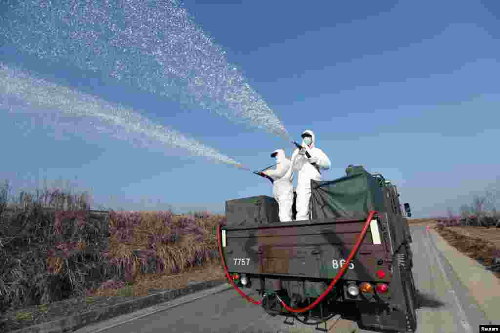 South Korean navy soldiers disinfect in Changwon.