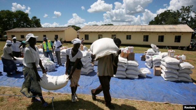 Zimbabwean villagers collect their monthly rations of food aid about 254km north of Harare on March 7, 2013.
