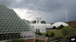 In this July 31, 2015 photo, several of the main buildings of the Biosphere 2 complex, including the tropical rainforest, the technosphere, and the south lung, in Oracle, Ariz. (AP Photo/Ross D. Franklin)