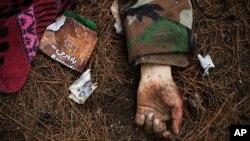 Thi thể của binh sĩ chính phủ Syria sau một cuộc giao tranh dữ dội tại Tal Sheer.