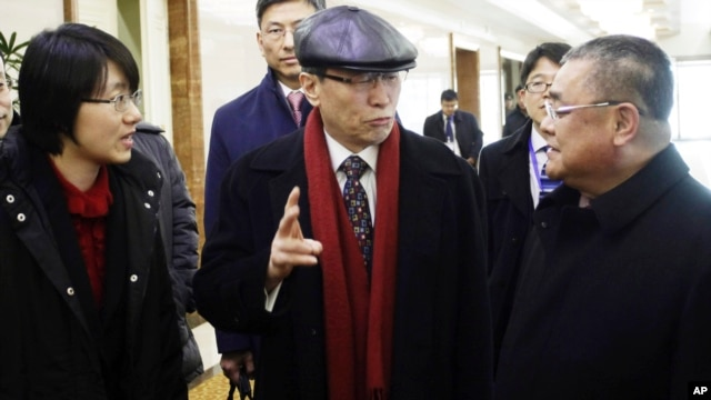 Wu Dawei, center, China's special representative for Korean Peninsula Affairs, is greeted by Pak Song Il, right, deputy director of the America department at the North Korean Foreign Ministry, upon arrival in Pyongyang, Feb. 2, 2016.