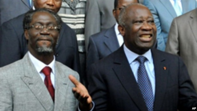 Ivory Coast's incumbent President Laurent Gbagbo (R) with Prime Minister Gilbert Ake N'gbo (L) and other ministers at the Presidential palace in Abidjan on December 7, 2010.