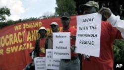 People demonstrate outside the Embassy of Swaziland in Pretoria on April 12, 2011 to support planned protests against the rule of King Mswati III