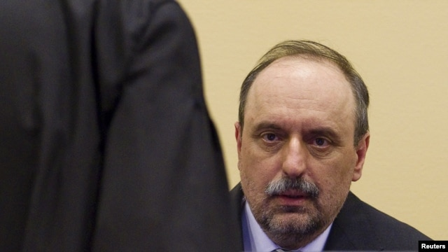 Goran Hadzic, the last of Serbia's alleged war criminals, makes his initial appearance to stand trial on crimes against humanity at the International Criminal Tribunal for the former Yugoslavia (ICTY) in the Hague July 25, 2011.