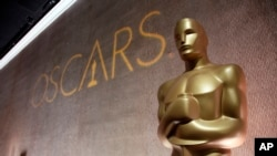 FILE - A giant Oscar statuette is seen at the 88th Academy Awards Nominees Luncheon in Beverly Hills, Calif.