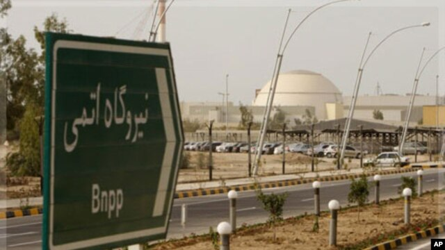 "A sign reading ""Atomic Power plant"" points the way to the nuclear power plant in Bushehr, Iran,  Feb. 25, 2009."