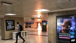 "A man blows up an explosive device in the station in Brussels, Belgium, June 20, 2017. The man was shot by soldiers afterwards in what prosecutors are treating as a ""terrorist attack."""