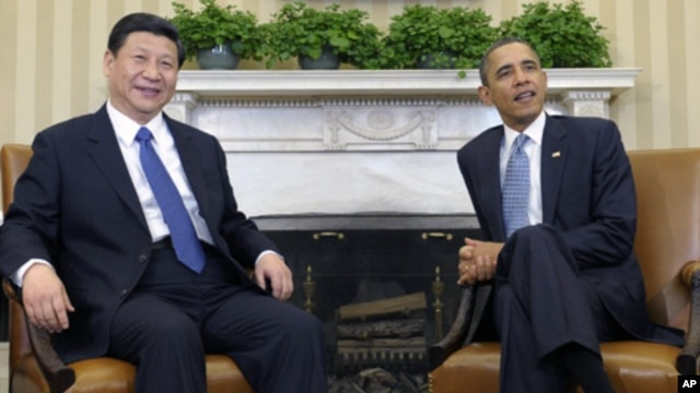 President Barack Obama meets with Chinese Vice President Xi Jinping, February, 14, 2012, in the Oval Office of the White House in Washington.